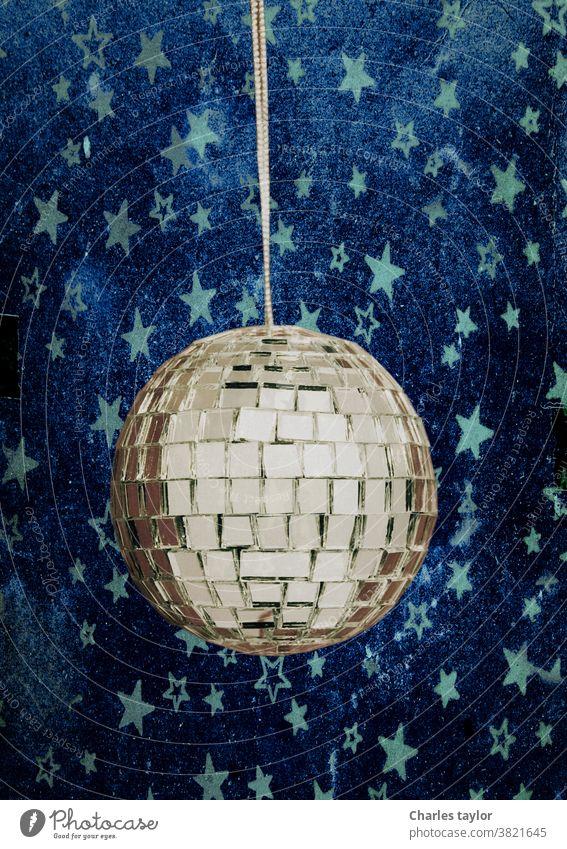 retro disco ball with stars 1970s blue night sky stars silver celebration cheesy colorful dance decoration disco-ball discoball discotheque effect electronic
