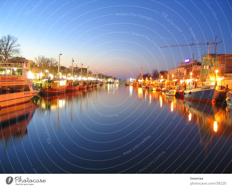 Warnemünde by night Nature Water Sky Cloudless sky Bay Lake River Fishing village Harbour Passenger ship Fishing boat Watercraft Yacht harbour Anchor Rope Dark