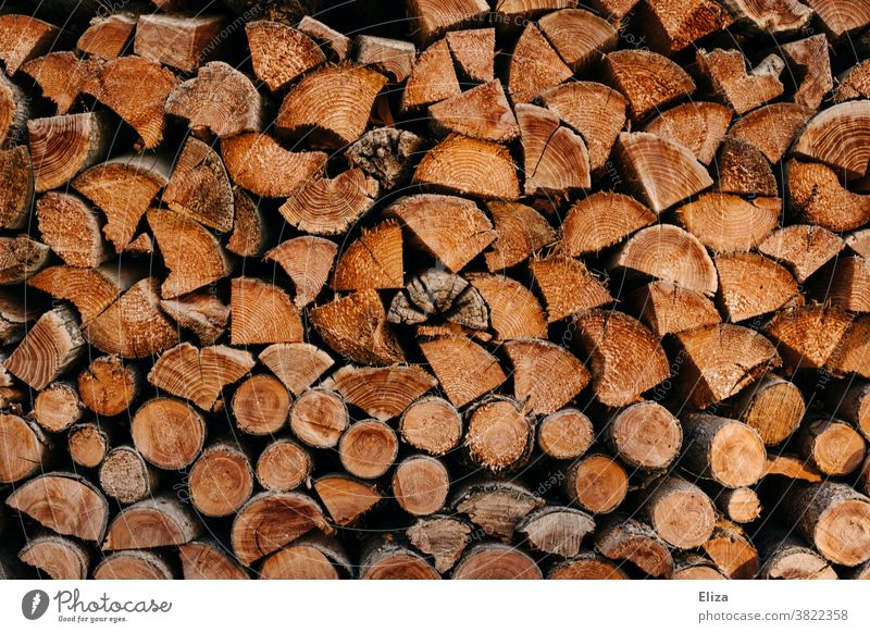 Stacked logs as firewood Logs stacked Wood Firewood Brown Wood chopping Stack of wood background texture