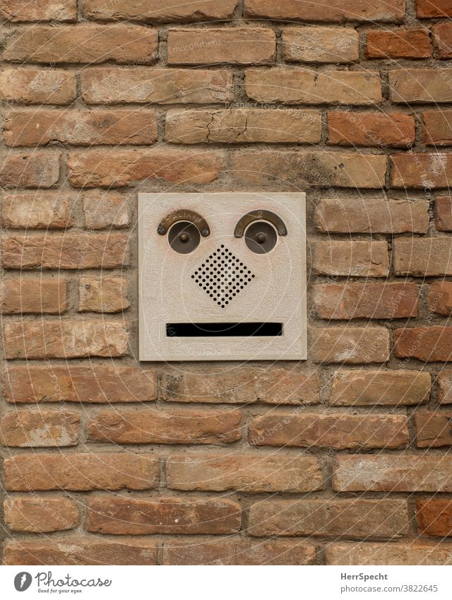 Mailbox with face Mailbox slot Brick wall Face grimace Funny Exterior shot Central perspective Wall (barrier) Copy Space bottom Town Subdued colour