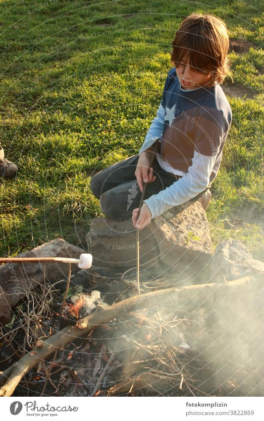 Child at campfire grilling marshmallows foam sugar Delicious cute BBQ Smoke Fireplace Boy (child) Parenting Childhood memory Infancy Nature be out country lust