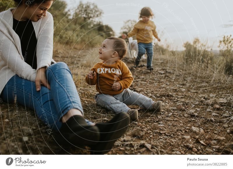 Mother with two children playing outdoors Family & Relations family Mother's Day motherhood Brothers and sisters Toddler Nature Authentic Lifestyle Child