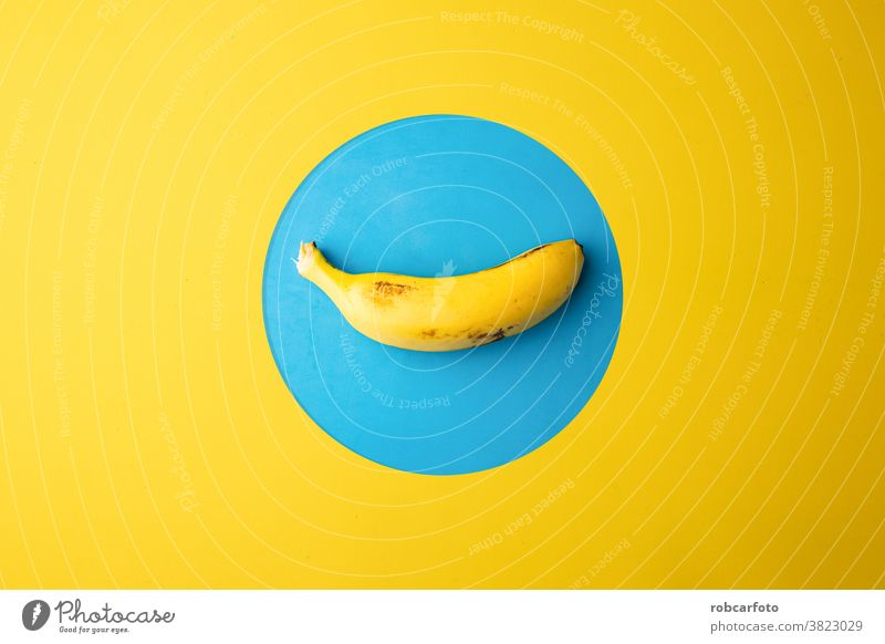 banana in yellow and blue background fresh healthy closeup tropical food ripe snack fruit peel white isolated sweet bunch group stack open flesh vitamin