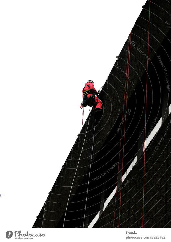 A climber Man labour Facade House (Residential Structure) Shopping center Climbing Sky
