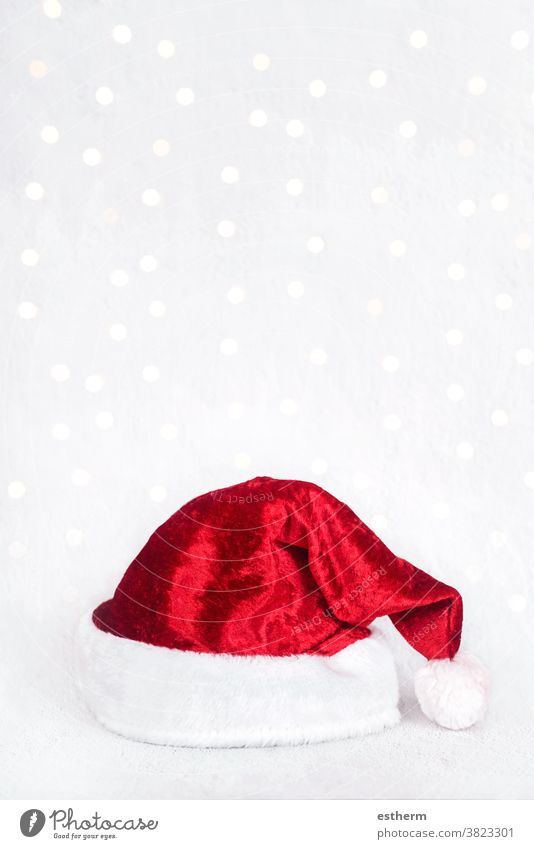 Merry Christmas.Red santa hat isolated over Christmas lights christmas santa claus fun celebration Christmas present christmas eve happiness joy happy
