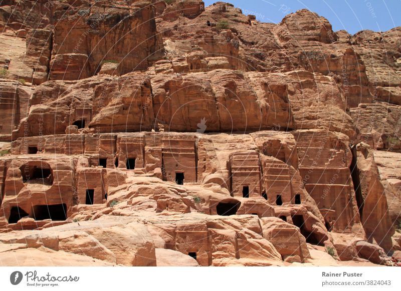 Monumental building carved out of rock in the ancient Jordanian city of Petra. architecture culture desert desert city exterior facade historic history jordan