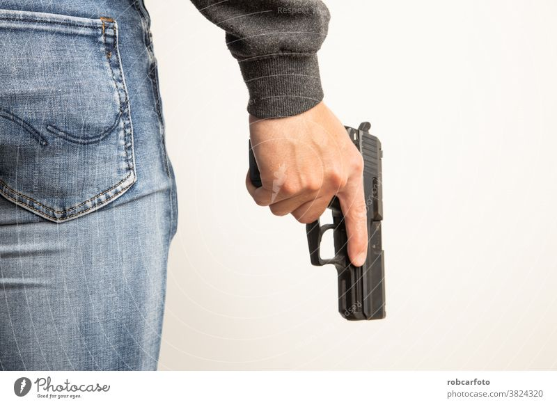 man with black pistol gun handgun police violence crime weapon white background army criminal attack defense security danger firearm war equipment metal