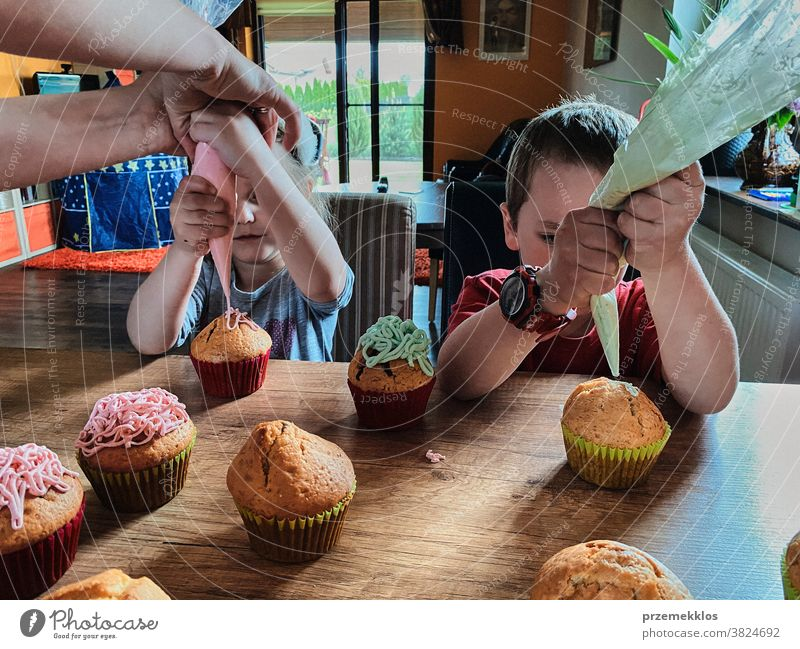 Children baking cupcakes, preparing ingredients, decorating cookies children cooking bake family domestic muffin together childhood happy little kid kitchen