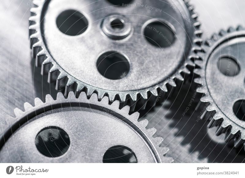 Three gear wheels mesh with each other Gearwheel Industry Impulsion Teamwork Network Metal Gear unit Engines Economy Business Infrastructure Mechanics