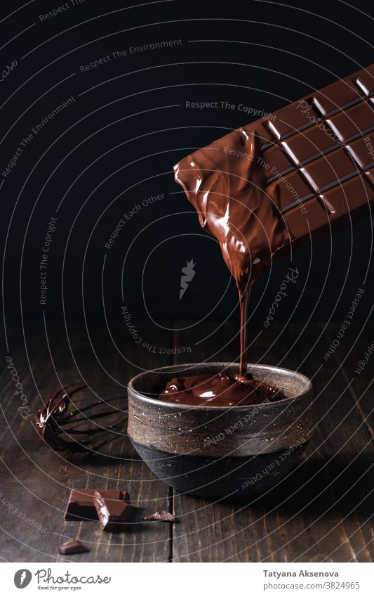 Dripping melted chocolate dark pouring hot texture dripping sweet cocoa food brown liquid ingredient dessert cooking creamy delicious tasty flowing confection