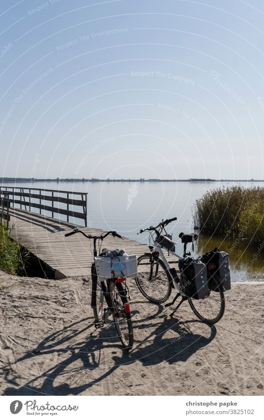 Two bicycles stand at the lake Bicycle Lake Bodden Bodden landscape Mecklenburg-Western Pomerania bike tour Cycling tour Boddenlandscape NP Nature