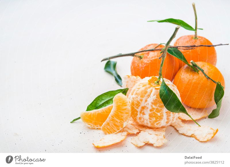 Tangerine fresh  with leaves close up agriculture breakfast citrus closeup food fruit green group harvest healthy leaf mandarin natural nature needle object