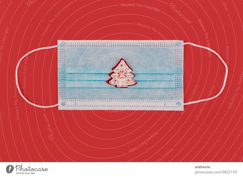 Merry Christmas.Protective surgical mask with christmas ornament santa claus coronavirus Christmas background protective surgical mask santa claus hat copyspace