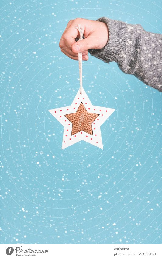 Merry Christmas.Child hand holding a Christmas star. child christmas santa claus fun celebration Christmas present christmas eve snowflakes happiness joy happy
