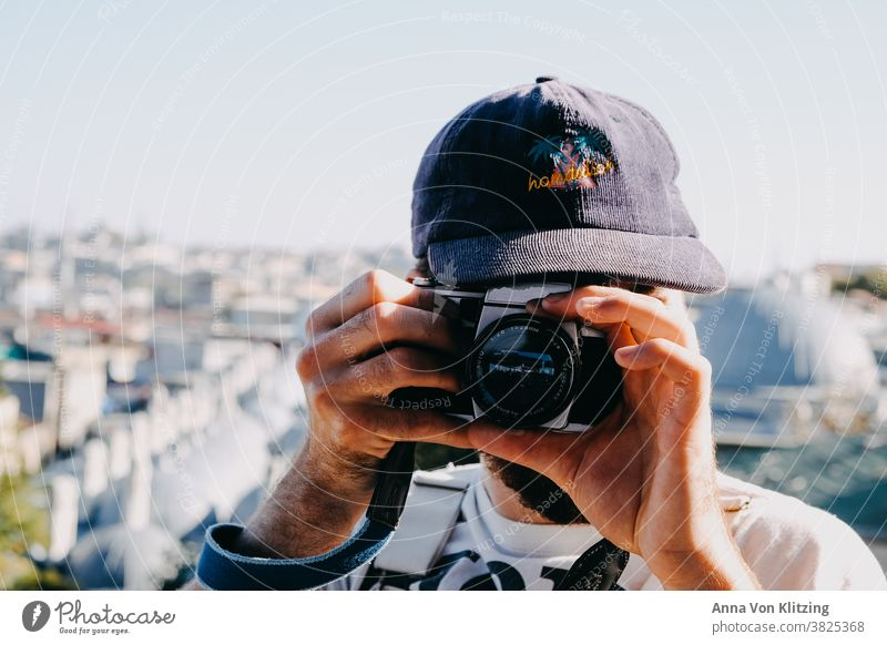 Analogue photography Photography cap Sunlight Single-lens reflex camera hands Man Town City trip Male Hands Hipster Camera Summer travel Travel photography