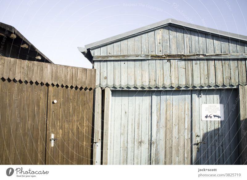 just beside it (update) is towed away Wooden hut Goal Architecture Facade Signs and labeling Garage Garage door Highway ramp (exit) Brandenburg an der Havel