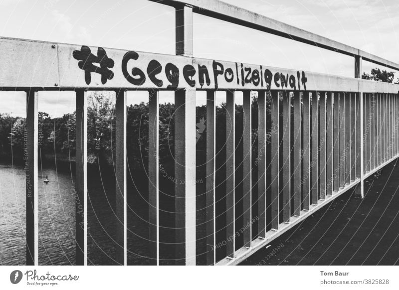 #against police brutality Police Force police violence Graffiti Bridge railing Black & white photo Politics and state Protest Exterior shot Characters Society
