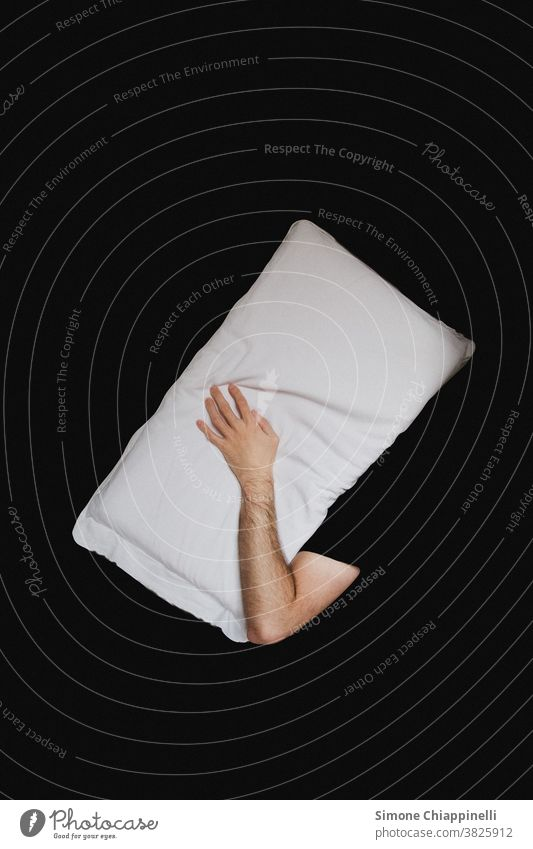 Sleeping with pillow on your head on a black background Black Pillow Abstract conceptually white pillow Bed Cushion Dream White Calm