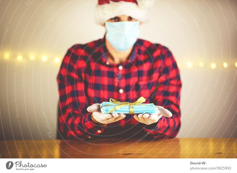 Corona - Christmas presents in quarantine corona Safety prevention pandemic Healthy Gift Mask Giving of gifts anxiously Protection Corona virus