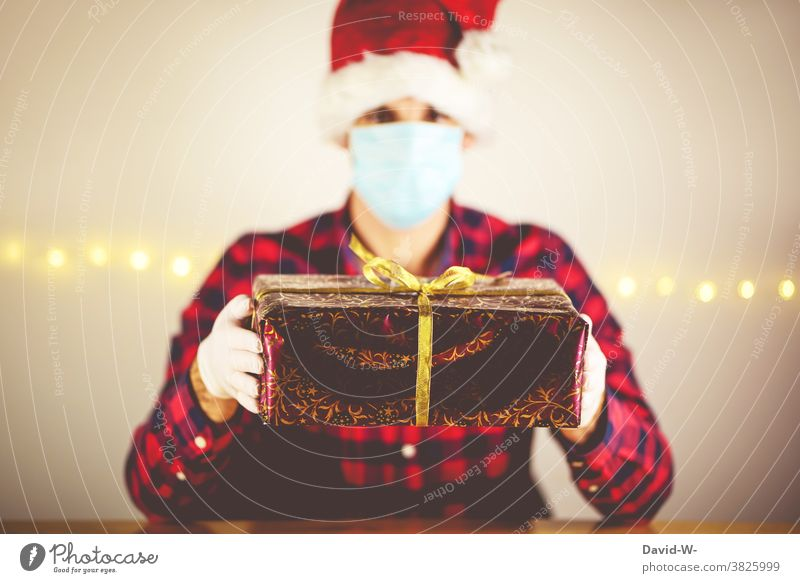 Corona - Christmas in quarantine corona Quarantine Man infected pandemic Respirator mask Mask Gift Giving of gifts by oneself