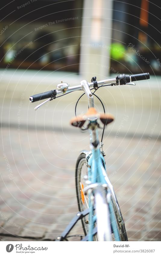 a parked locked bicycle Bicycle Town completed turned off Retro Turquoise Handlebars Parking Bicycle handlebars Cycling