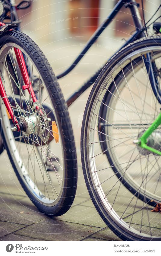 colourful bicycles stand on the street Bicycle Wheel Tire Bicycle tyre Stand Town variegated Parking Cycling Spokes Transport Means of transport