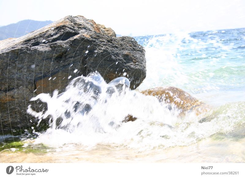 Rock in the surf Waves Ocean Refreshment Vacation & Travel Nature