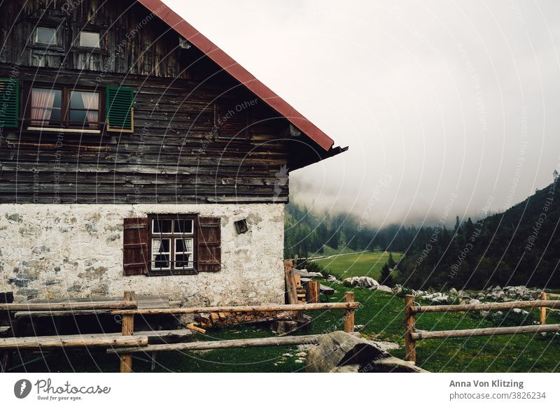 mountain hut mountains Hiking Bavaria Hut House (Residential Structure) Alpine pasture Quaint Wood Wooden window Fence Meadow Alps Break stop for a bite to eat