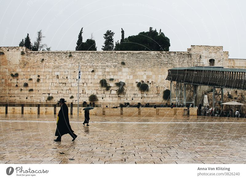 Wailing Wall in the Rain The Wailing wall West Jerusalem Israel orthodox stones Umbrella religion Religion and faith dressed in black religious devout Man