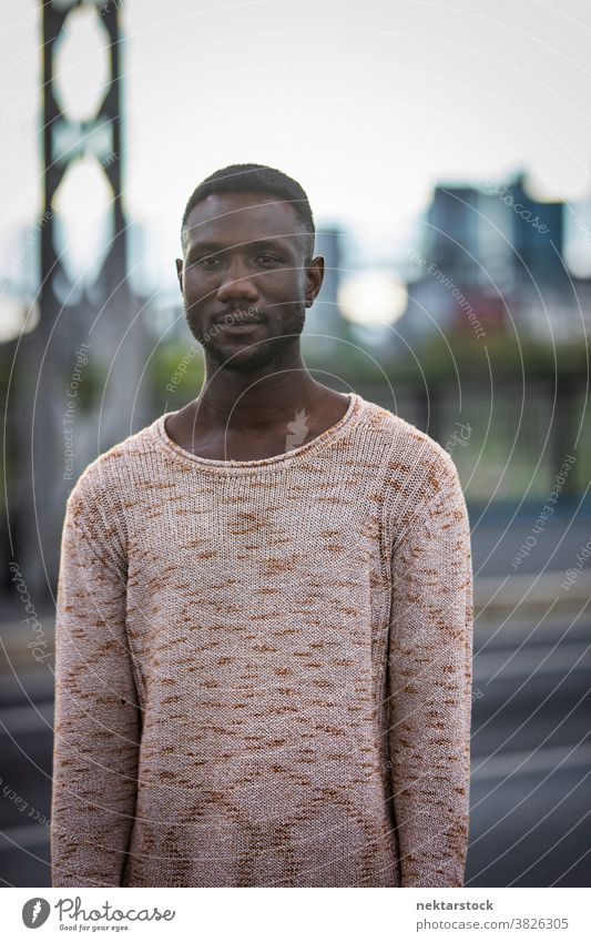 Handsome Black Man in Sweater Outdoors portrait man black pose African ethnicity looking away sweater fashion front view one person one man only 20-30 years old