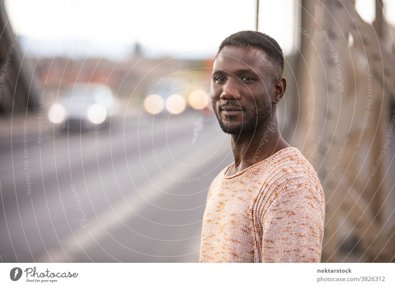 Portrait of Handsome Black Man with Car Traffic Background portrait man black african ethnicity head turned looking away one person one man only 20-30 years old