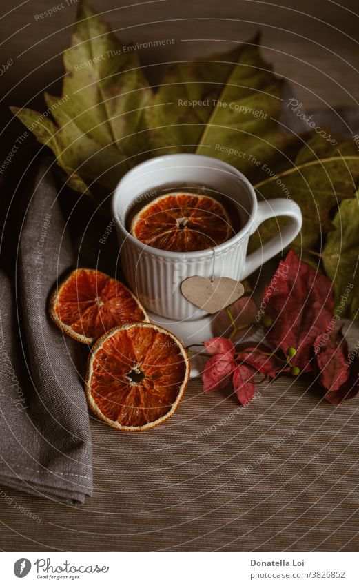 Cup of tea still life autumn colors cup drink dry fall food fruits heart indoor leaves light liquid moment morning orange porcelain studio shot warm white