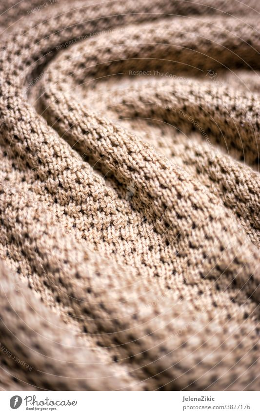 Knitted beige blanket texture background knit pattern warm wool fashion macro woolen woven cashmere soft fabric thread winter decorative natural material