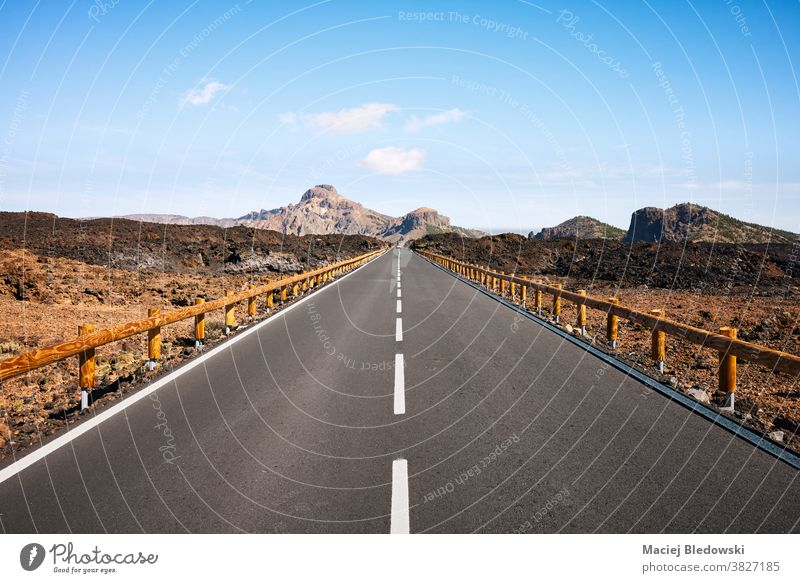 Scenic road in volcanic scenery, Tenerife, Spain. highway deserted travel road trip mountain landscape nature Canary Islands adventure vacation destination peak