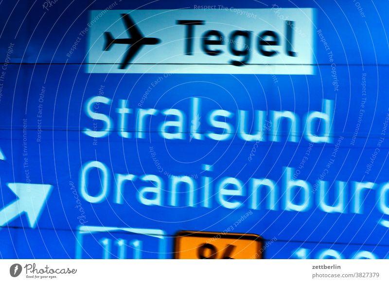Signposts to Tegel, Stralsund and Oranienburg Turn off Highway Lane markings Clue edge Curve Left navi Navigation Orientation Arrow Right Direction Street tip