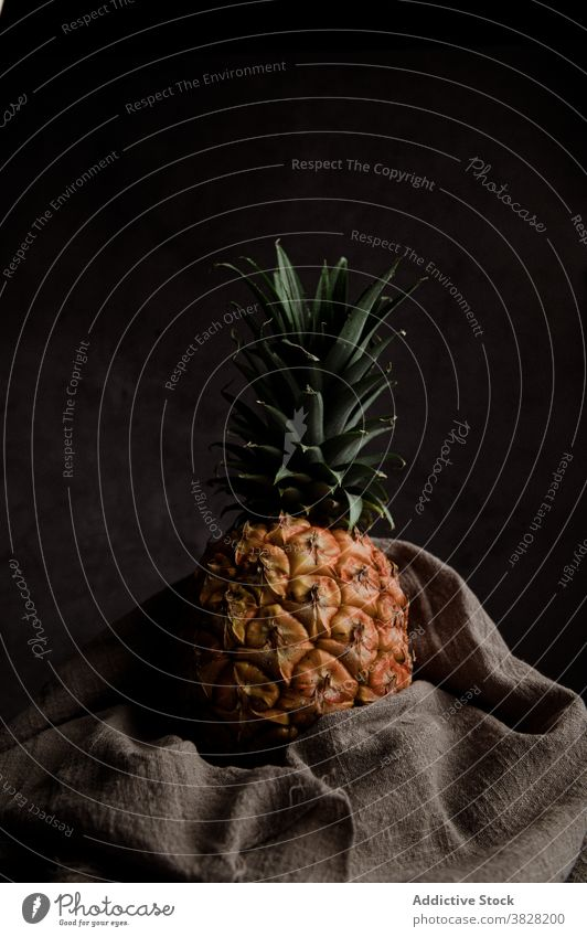 Sweet ripe pineapple in dark studio fruit fresh natural tropical exotic whole food nutrition vitamin raw ingredient diet vegan delicious healthy organic sweet