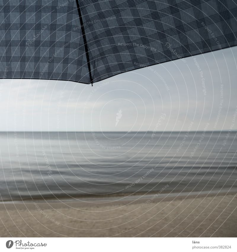 Covered Vacation & Travel Tourism Beach Ocean Environment Nature Landscape Sand Sky Loneliness Leisure and hobbies Checkered Umbrella Bad weather Horizon