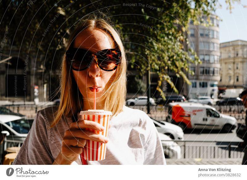 Freshly squeezed orange juice blond woman straw Drinking Mug Sunglasses centre parting freshly squeezed orange juice Summer Summer vacation City trip Istanbul