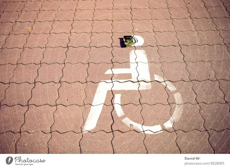 Wheelchair user symbol with breathing mask / coronavirus Mask obligation physical limitation Respirator mask disabled parking Disability friendly pandemic