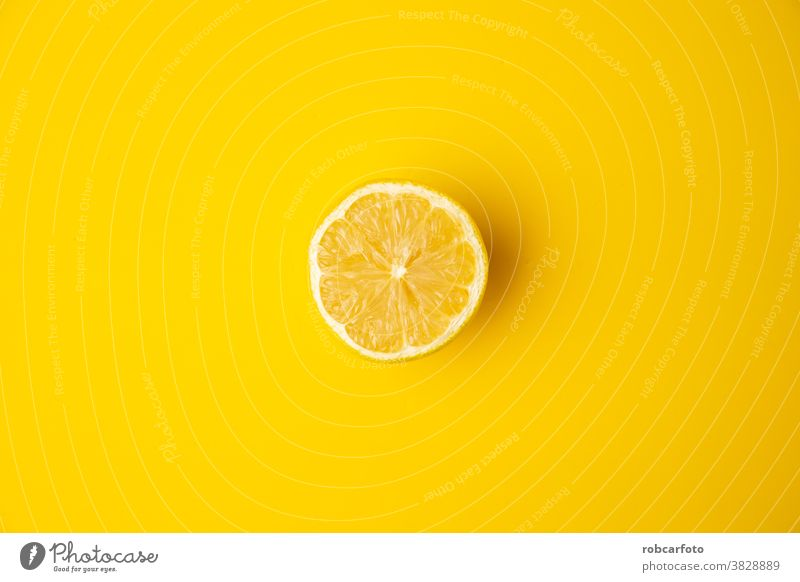 open lemon fruit on yellow background fresh isolated juicy healthy closeup food ripe sweet leaf succulent citrus juice ingredient vegetarian sour whole taste
