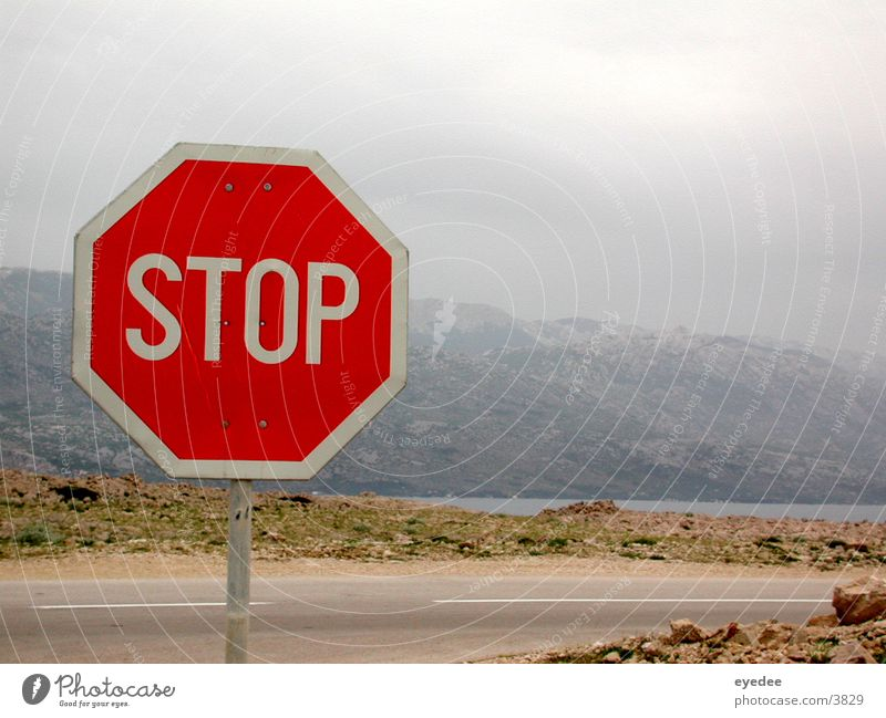 STOP! Stop sign Ocean Mountain Street Sparse Rock