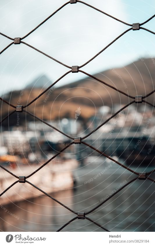 Fence with Beautiful view of a Canal and Mountains fence beautiful canal mountains Exterior shot Day Landscape Summer fencing canals italy boat boats protect