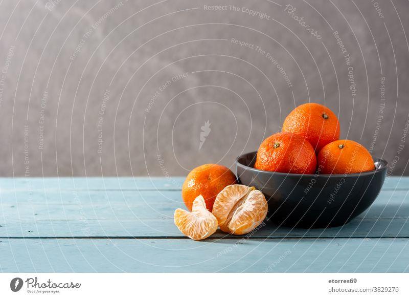 Fresh tangerines asian blue chinese citrus clementine food fresh fruit healthy isolated juice macro mandarin natural nature new year orange organic piece raw