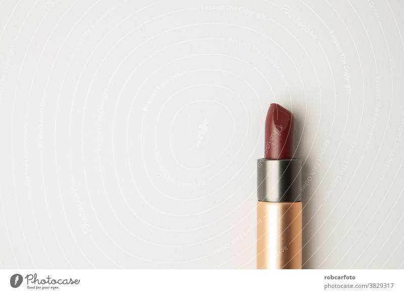 dark red lipstick on white background fashion care colour black isolated color beauty makeup object open accessory silver luxury tube standing single expensive