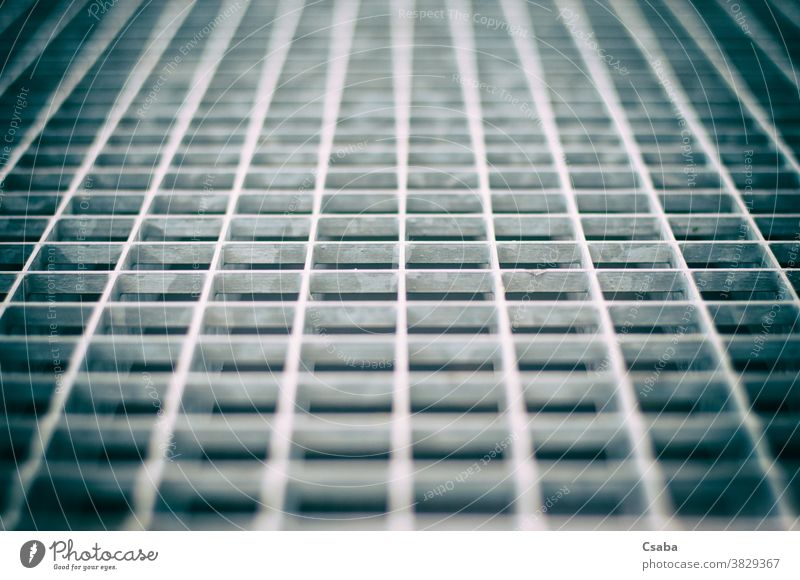 Closeup of an aged gray metal grid grate pattern detail metallic texture closeup steel iron structure abstract backdrop background geometric material design