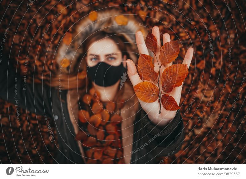 beautiful woman holding autumn leaves in hand autumn colors autumn vibes background caucasian celebration clean clothes clothing dark evil face fall fashion