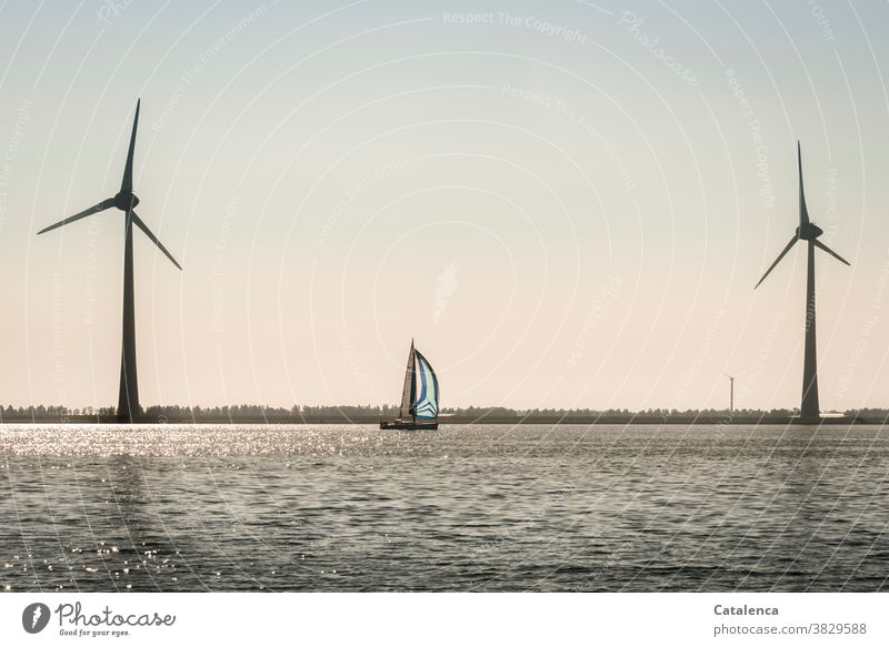 wind power Freedom daylight Blue Green Day Summer Sailing Vacation & Travel Sky Clouds Horizon sailing yacht Ocean Navigation windy Waves Water Nature windmills