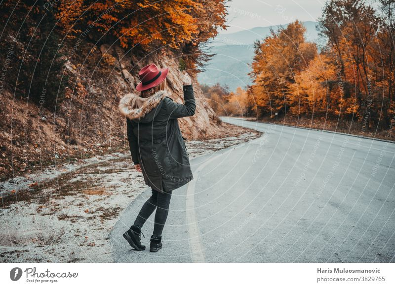Woman with hat exploring the autumn forest autumn colors autumn leaves autumn vibes background beautiful beautiful woman caucasian celebration clean clothes