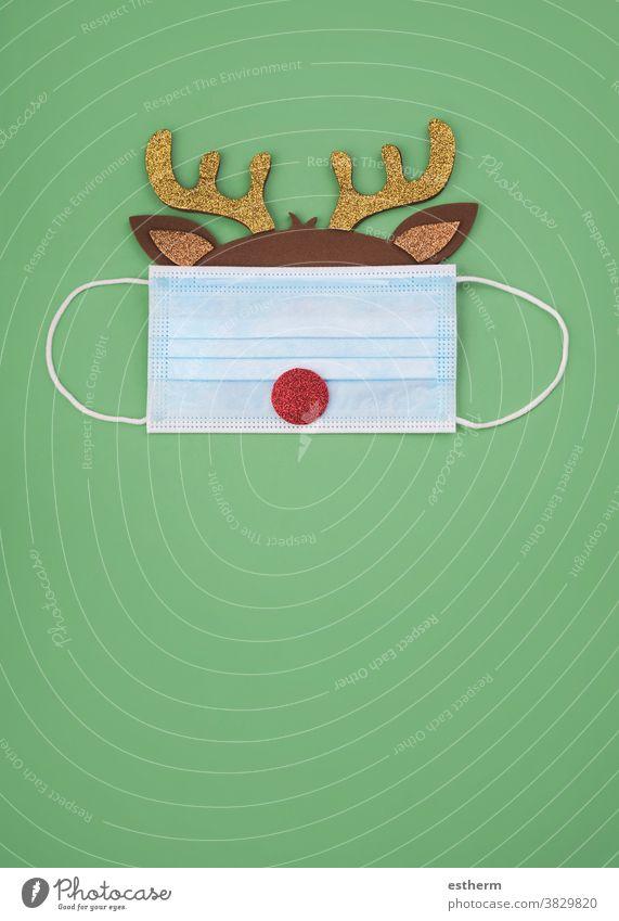 Merry Christmas.Christmas concept background.Christmas Rudolph Reindeer with protective surgical mask christmas santa claus coronavirus reindeer
