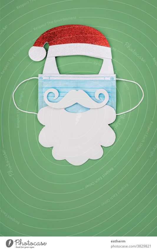 Merry Christmas.Christmas concept background.Santa claus with protective surgical mask christmas santa claus coronavirus Christmas background santa claus hat